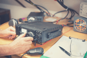 man adjusting ham radio base station