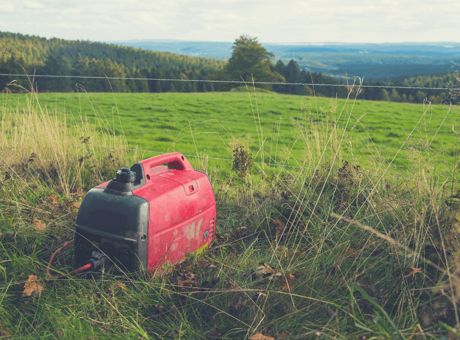 honda inverter generator sitting in a field