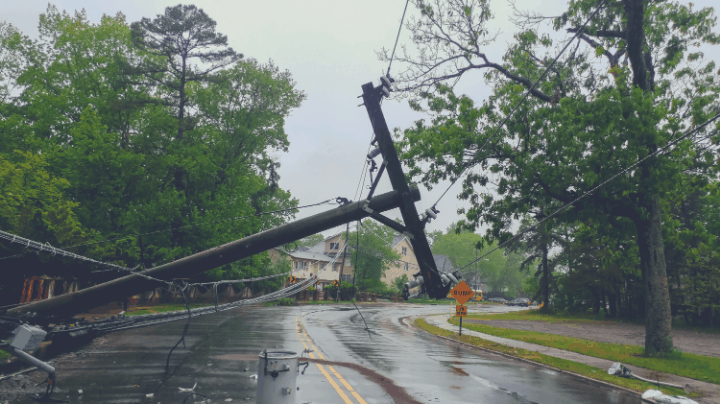 power line pole down across a street