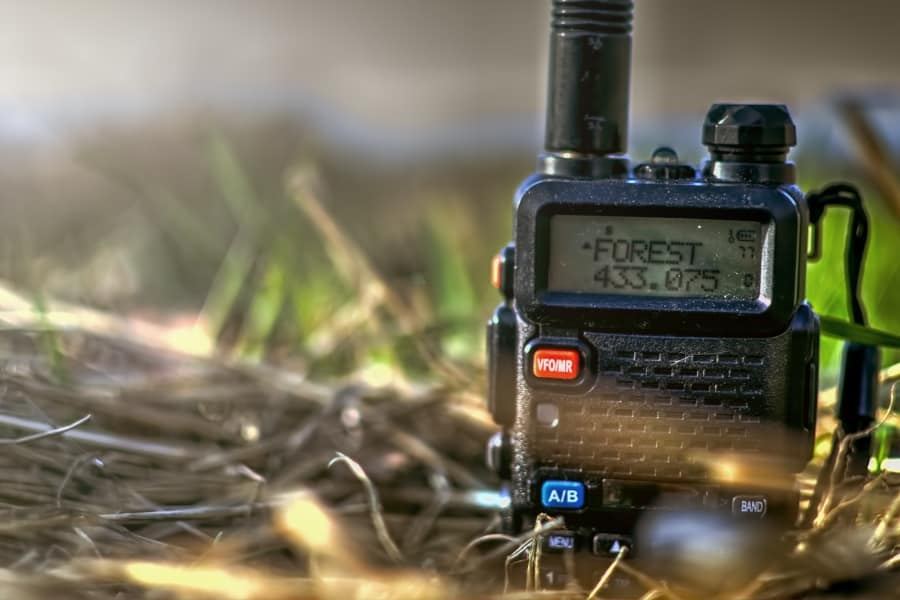 handheld cb radio on the ground in the woods