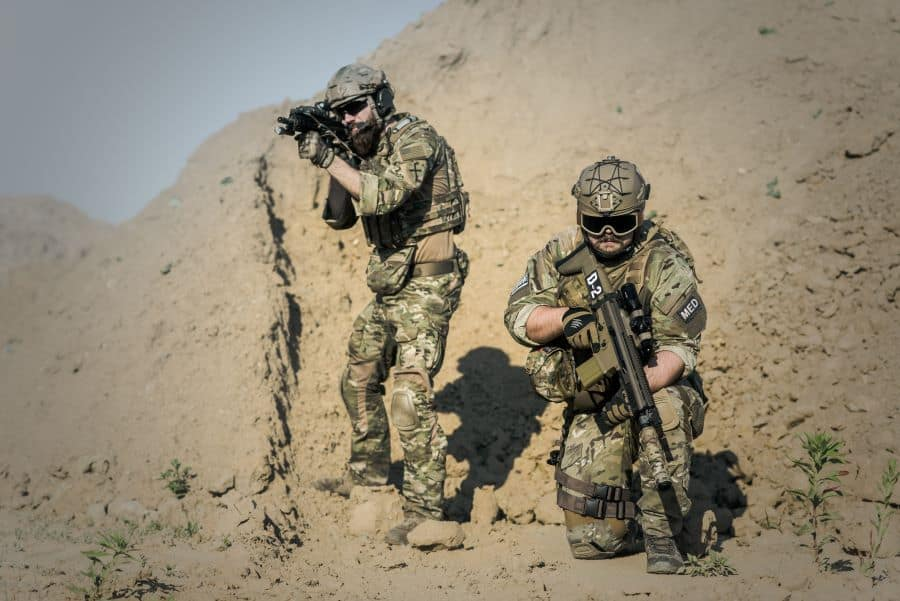 two men in full combat gear including combat boots